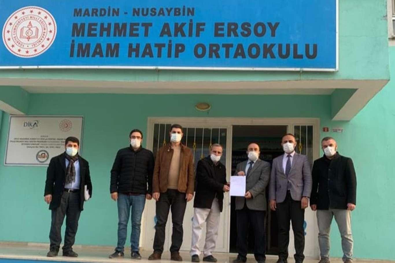 Öğretmen ve velilerden Suriye'ye konut yardımı